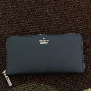 KateSpade crosshatched leather with matching trim.